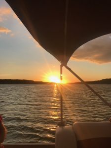 Book a sunset cruise on Lake Georgetown while visiting Scurlock Farms